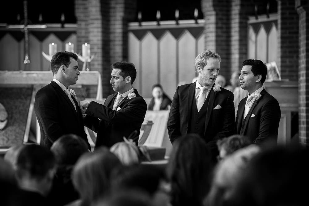 grooms and his groomsmen in church
