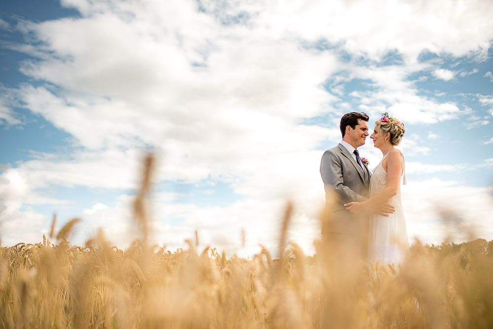corn field wedding photo at priory cottages