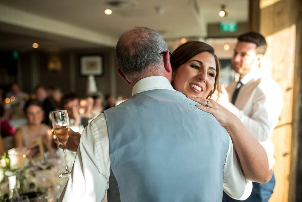 bride hugging her father at wedding at King street townhouse