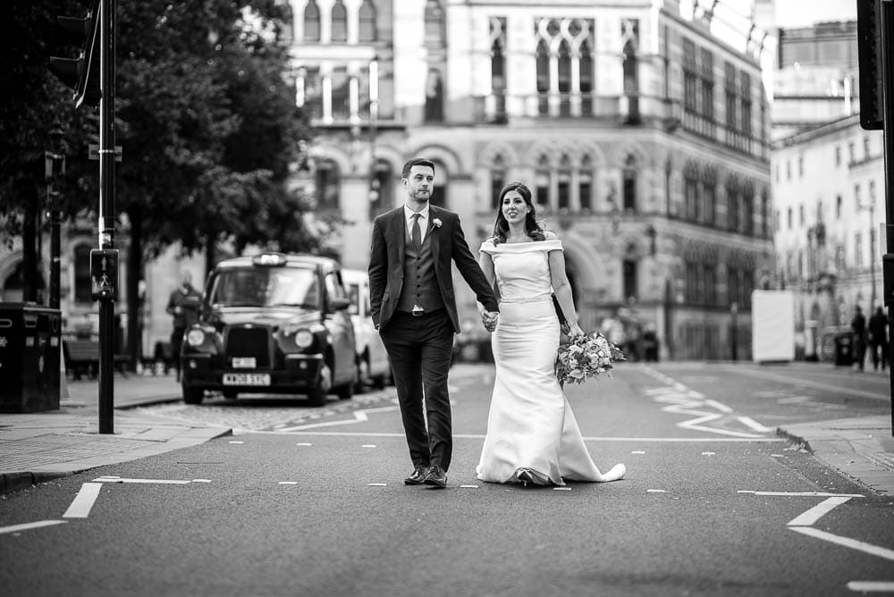 bride and groom in road
