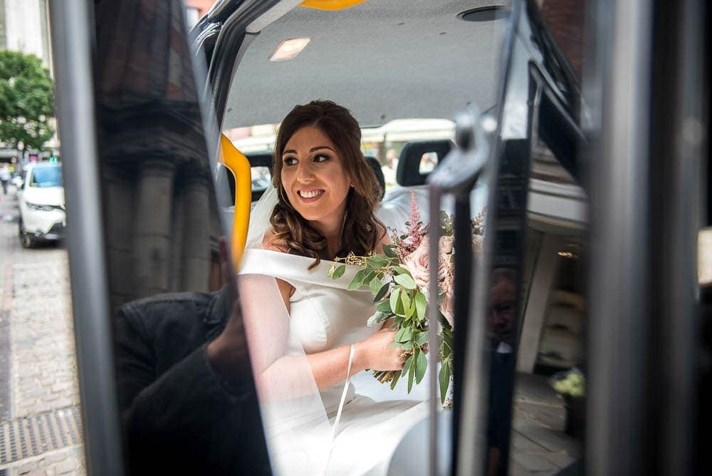 bride in taxi in manchester