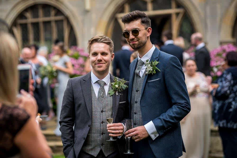 same sex couple pose for photos at rushton hall wedding