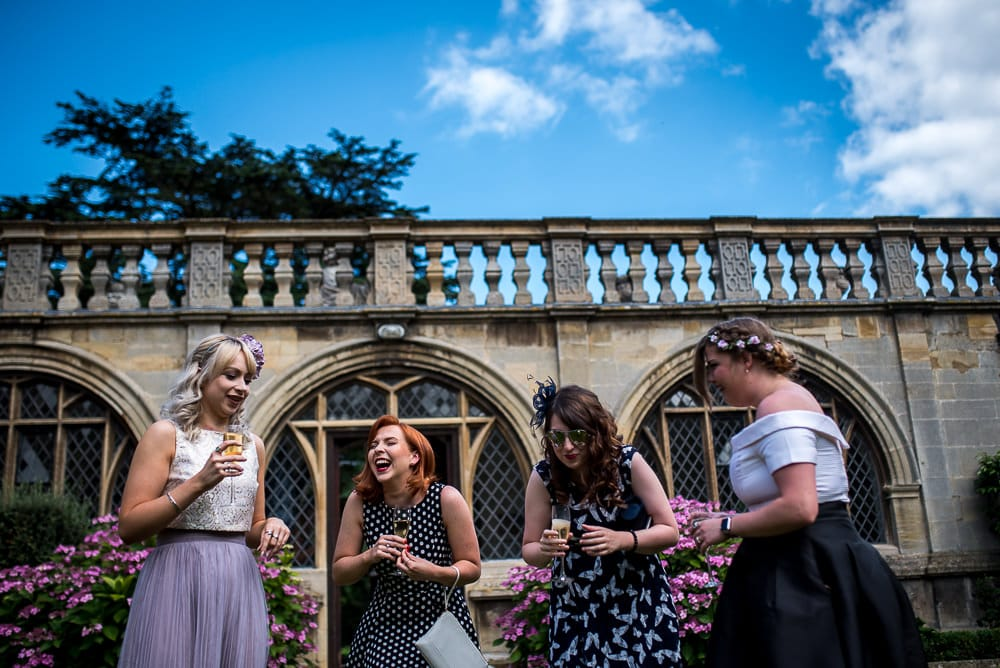 wedding guests laughing at rushton hall wedding
