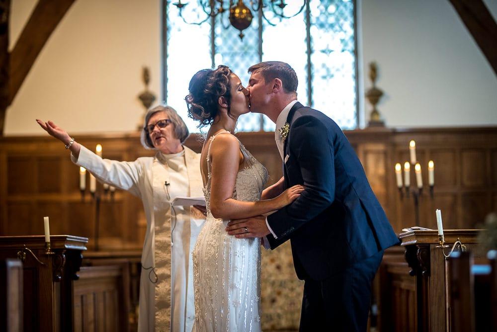 bride and groom kissing at church
