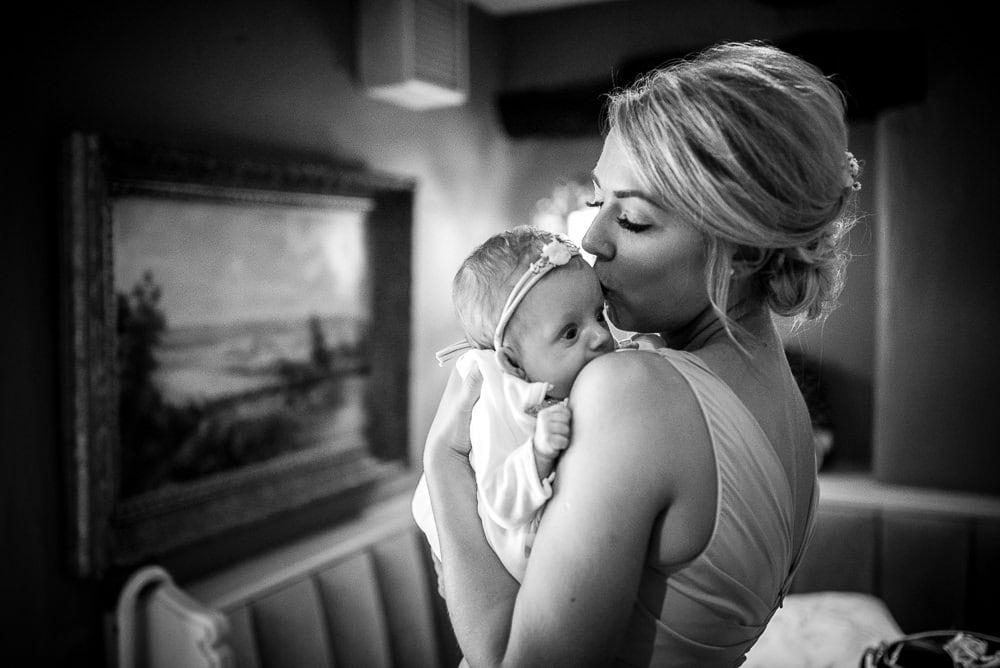 bridesmaid kissing baby