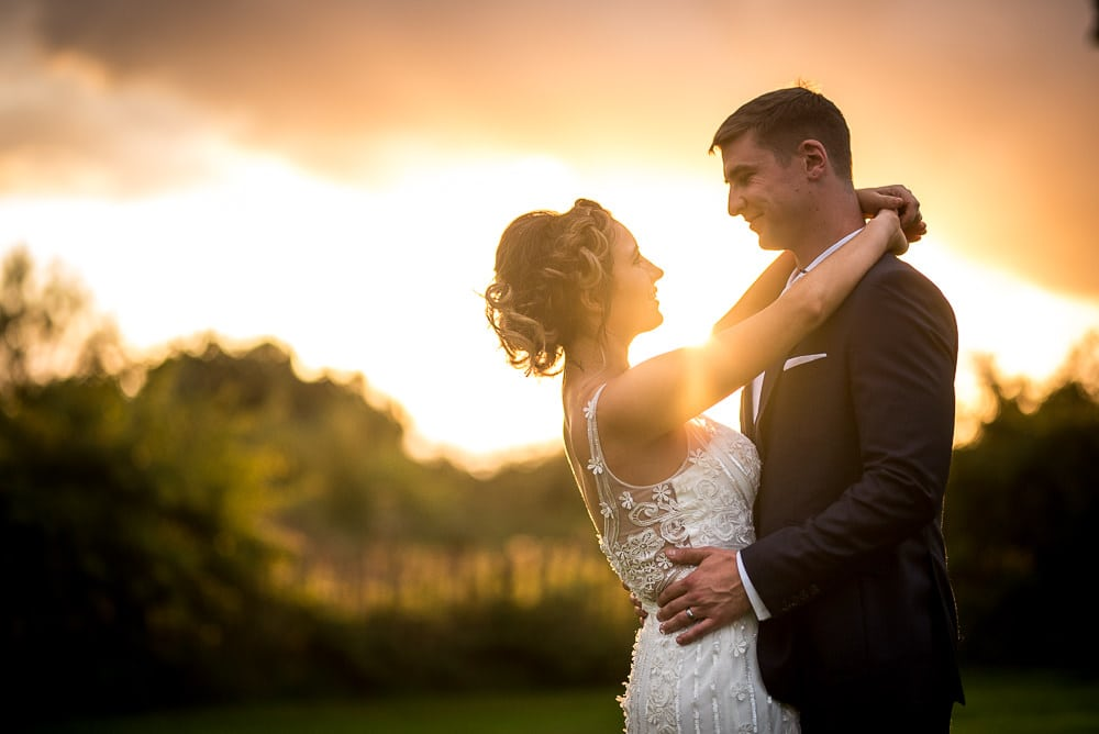 wedding couple in front of sunset