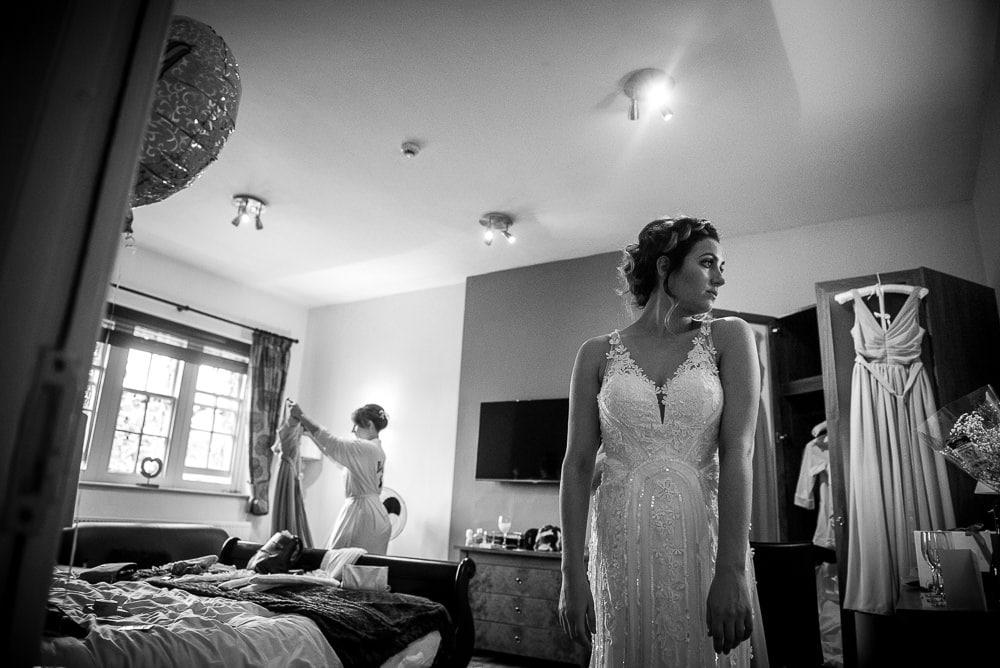 brid egetting in her wedding dress