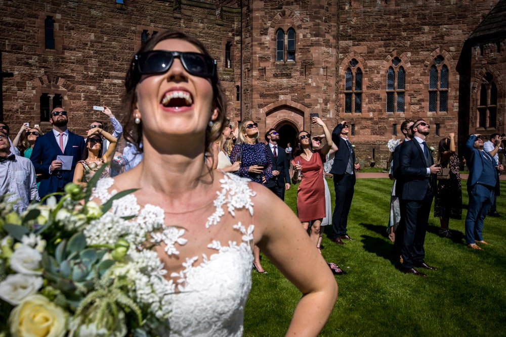 bride in sunglasses at Peckforton Castle Wedding