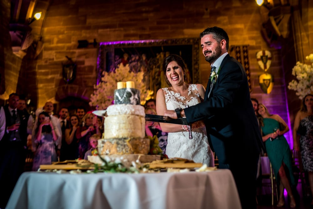 cake cut with sword at Peckforton Castle Wedding