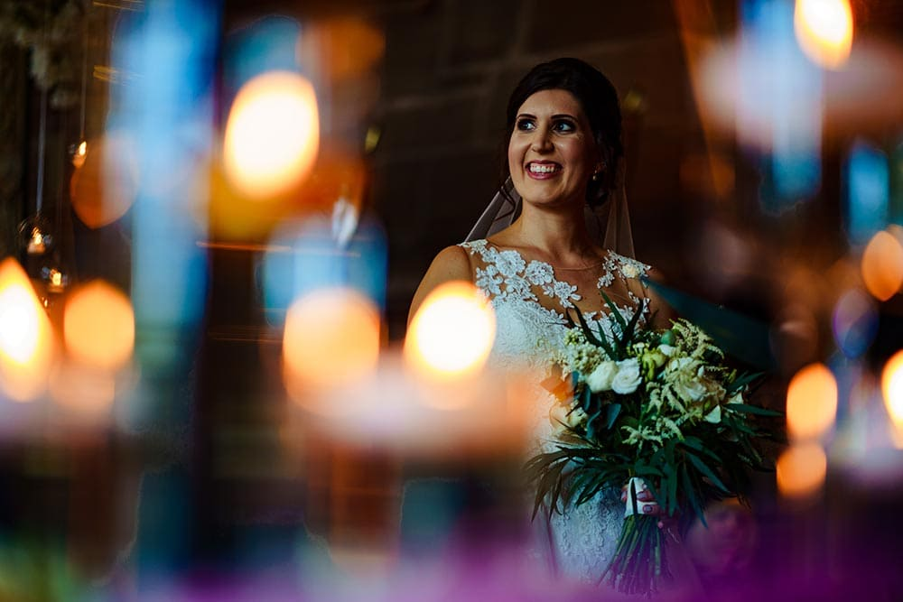 bride and candles at Peckforton Castle Wedding