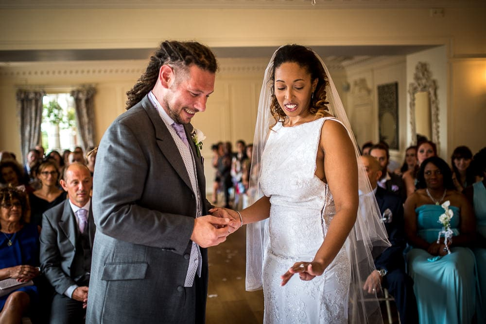 happy exchange of wedding rings at eaves hall