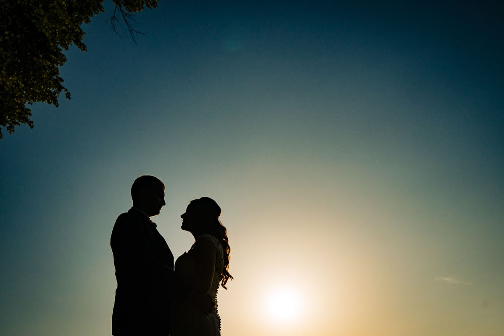 silhouette of bride and groom at mottram hall