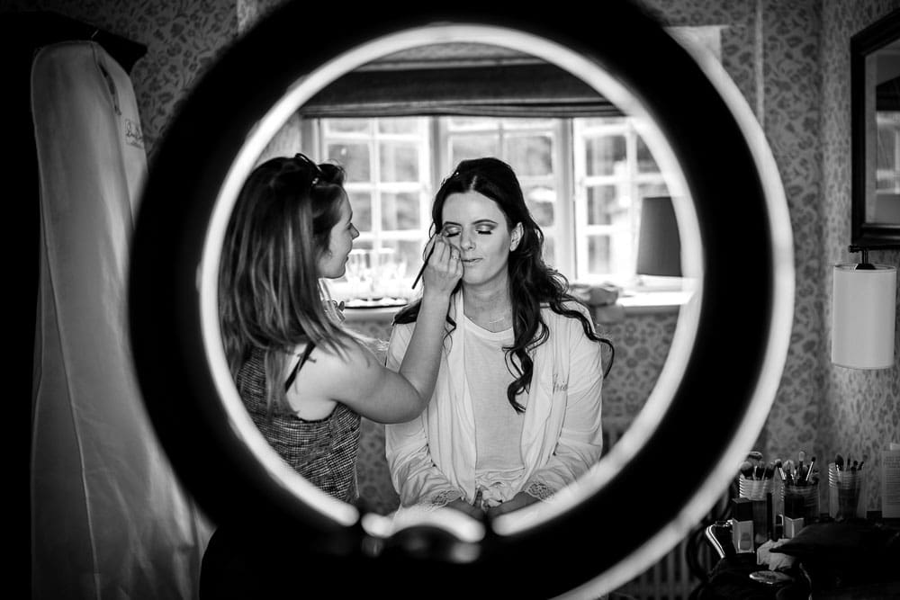 bride having make up at mottram hall