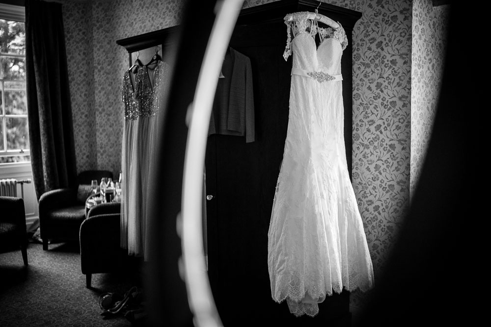 wedding dress hung up at mottram hall