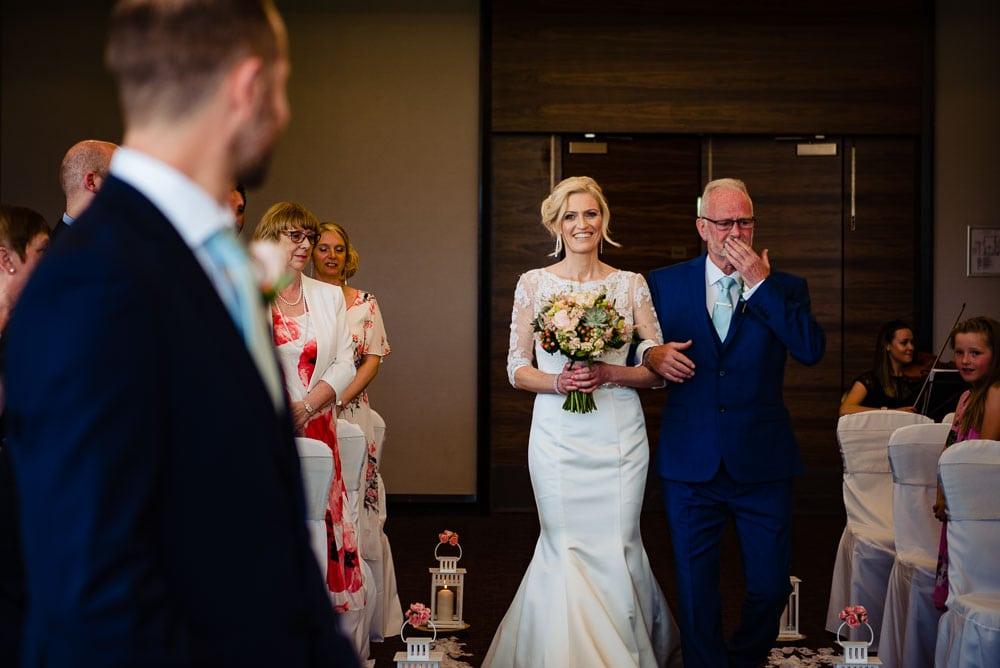 bride walking up the ailse