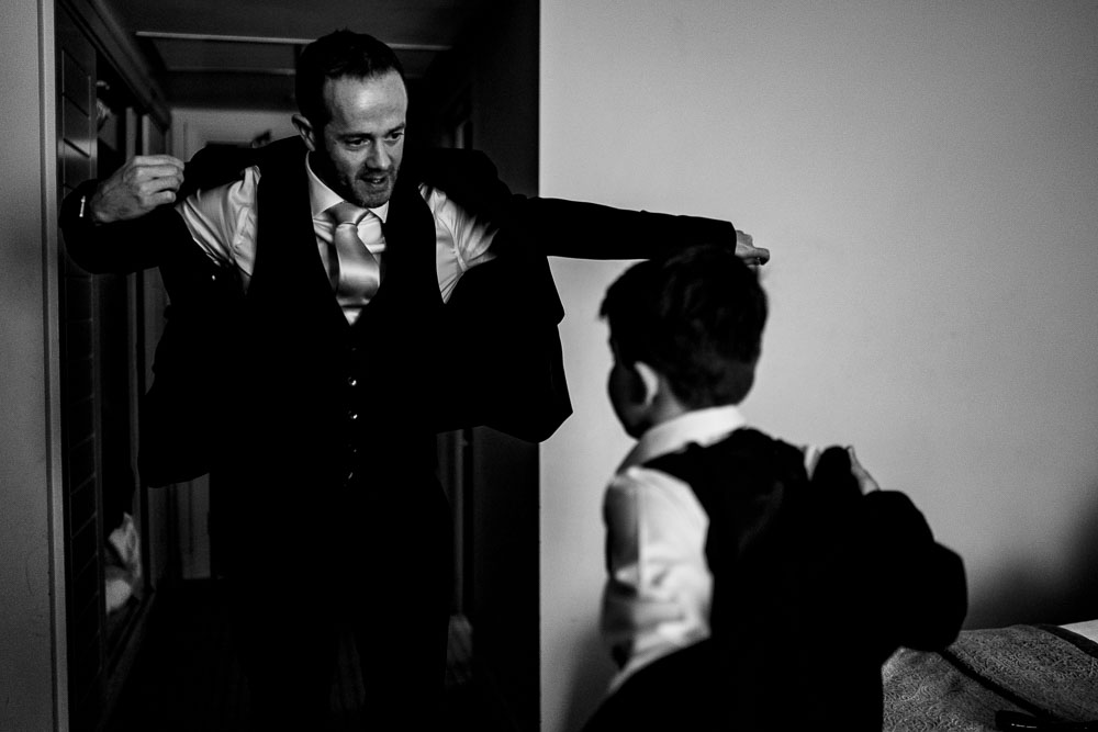 groom and son getting in jackets