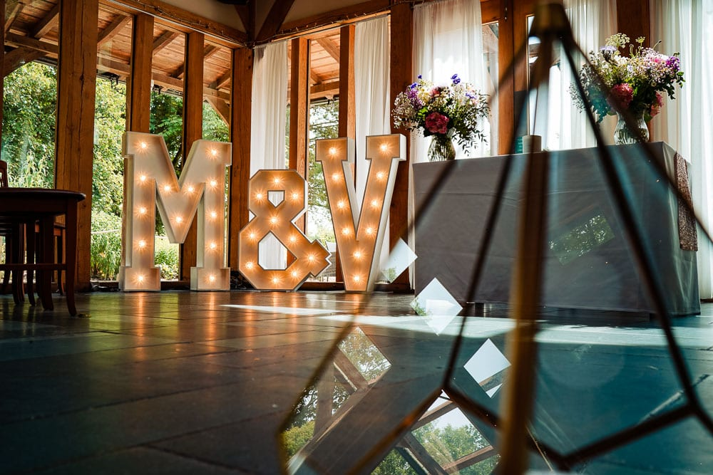 The Word is Love Light Up letters at Oak tree of peover wedding