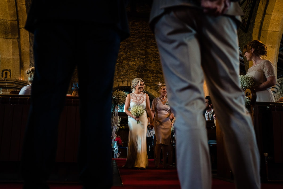 low angle of bride walking up the aisle