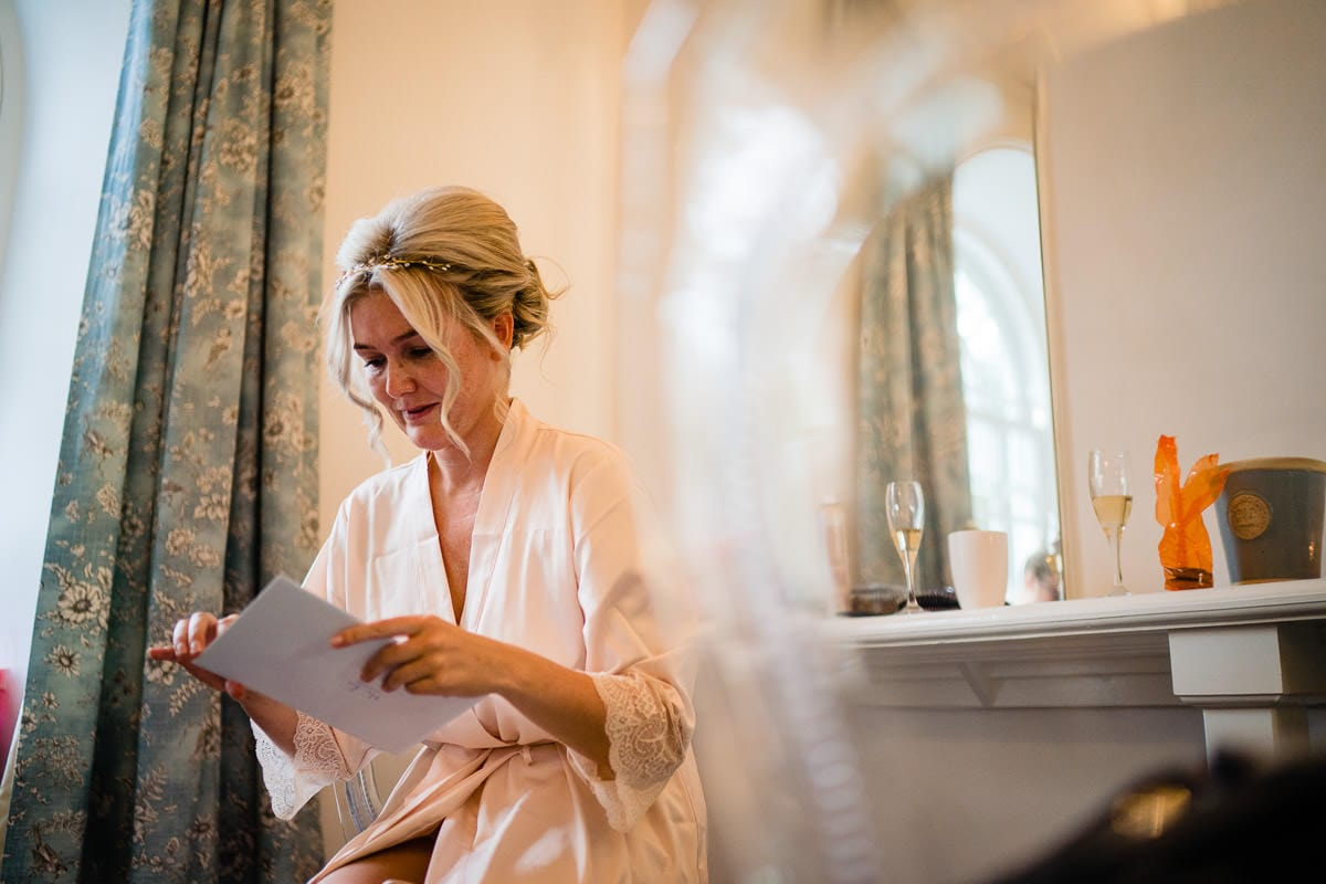 bride reading card from groom at gisburn park estate