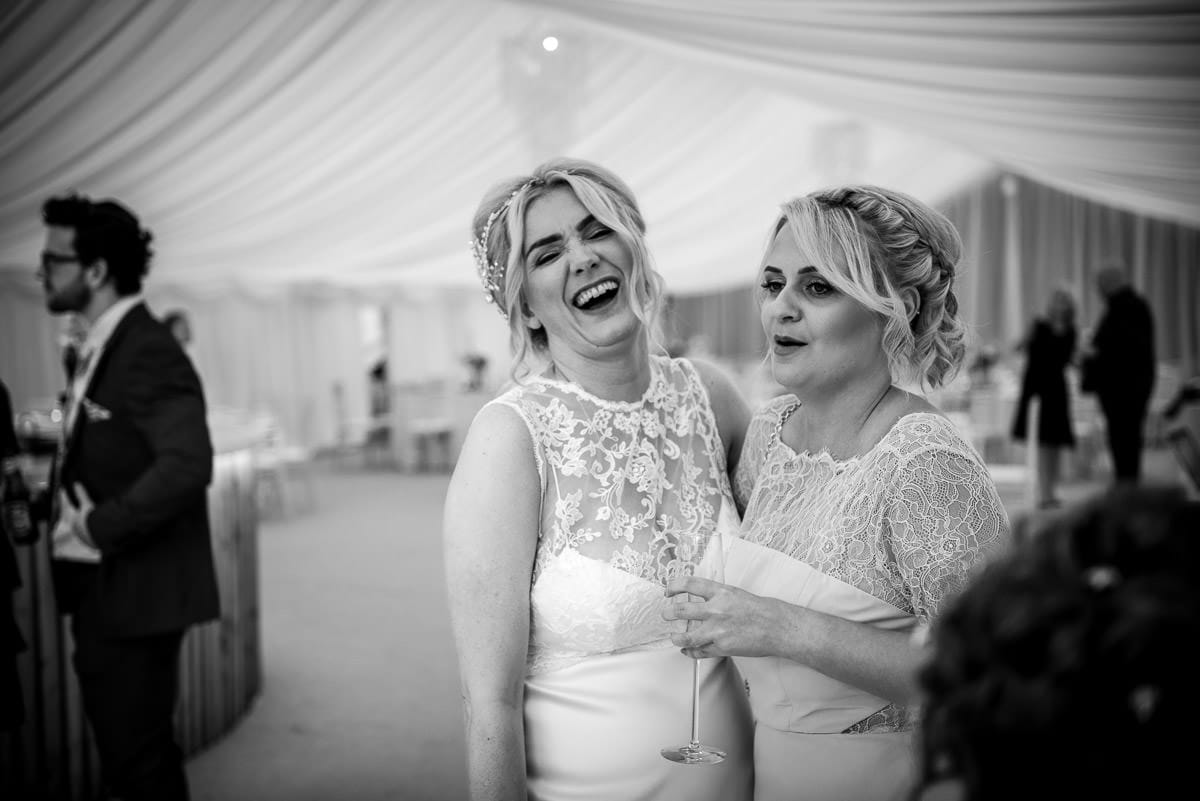 bride laughing with friend