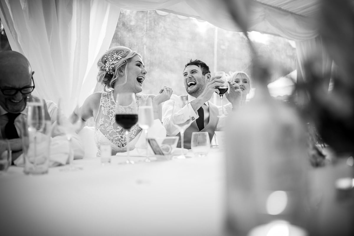 wedding top table laughing