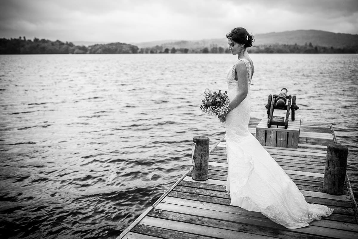 bride posing on jetty at lake windermere