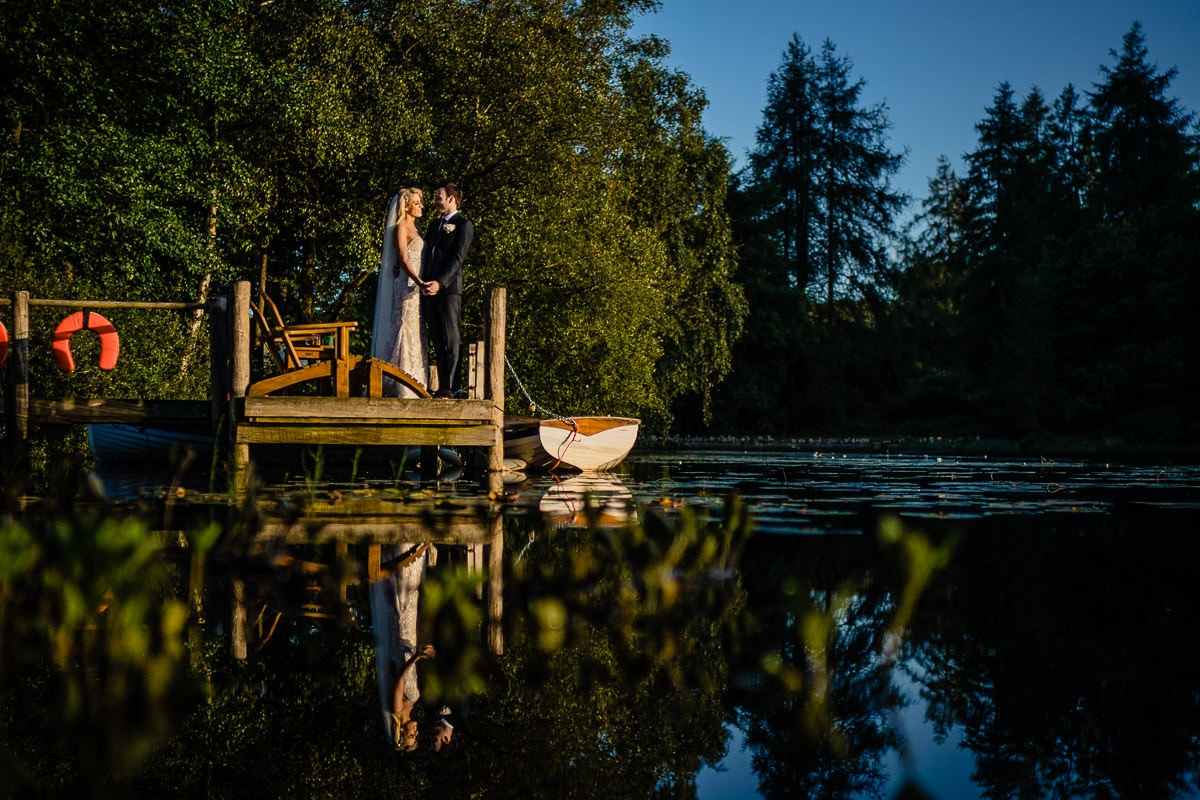 wedding couple on jetty at gilpin lake house