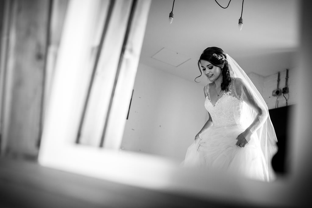 happy bride in a mirror