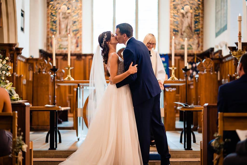first kiss at a church wedding