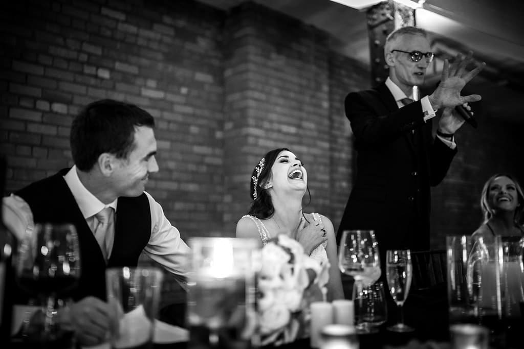 bride luaghing at her dads speech