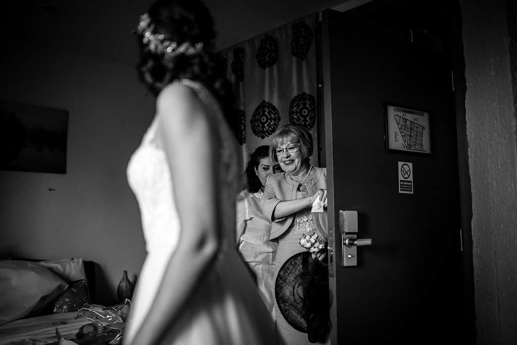 mum seeing daughter in her wedding dress