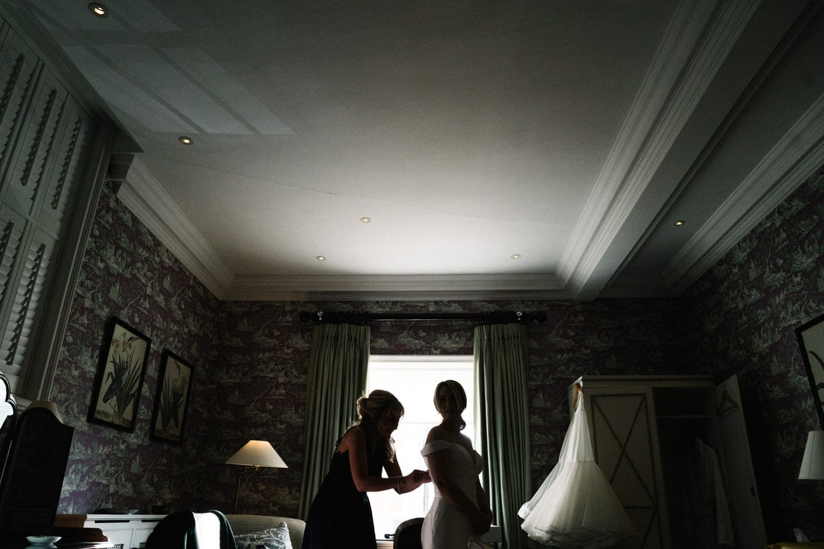 bride getting in her dress at knowsley hall
