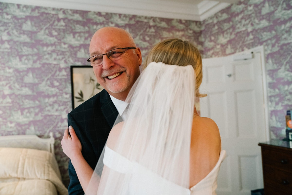 dad hugging daughter at knowsley hall