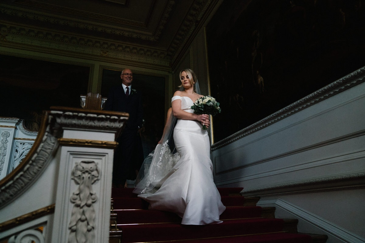 bride on staircase at knowsley hall