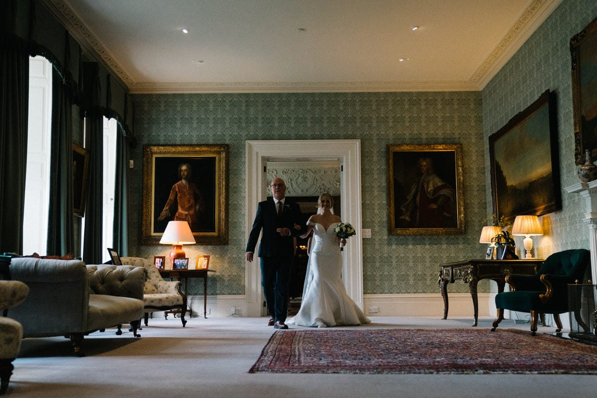 bride and her father walking through knowsley hall