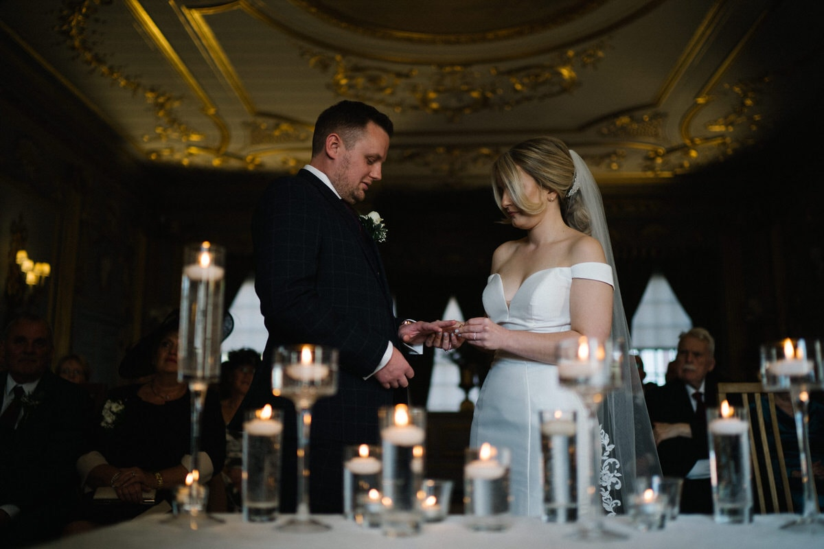 exchange of wedding rings at knowsley hall wedding