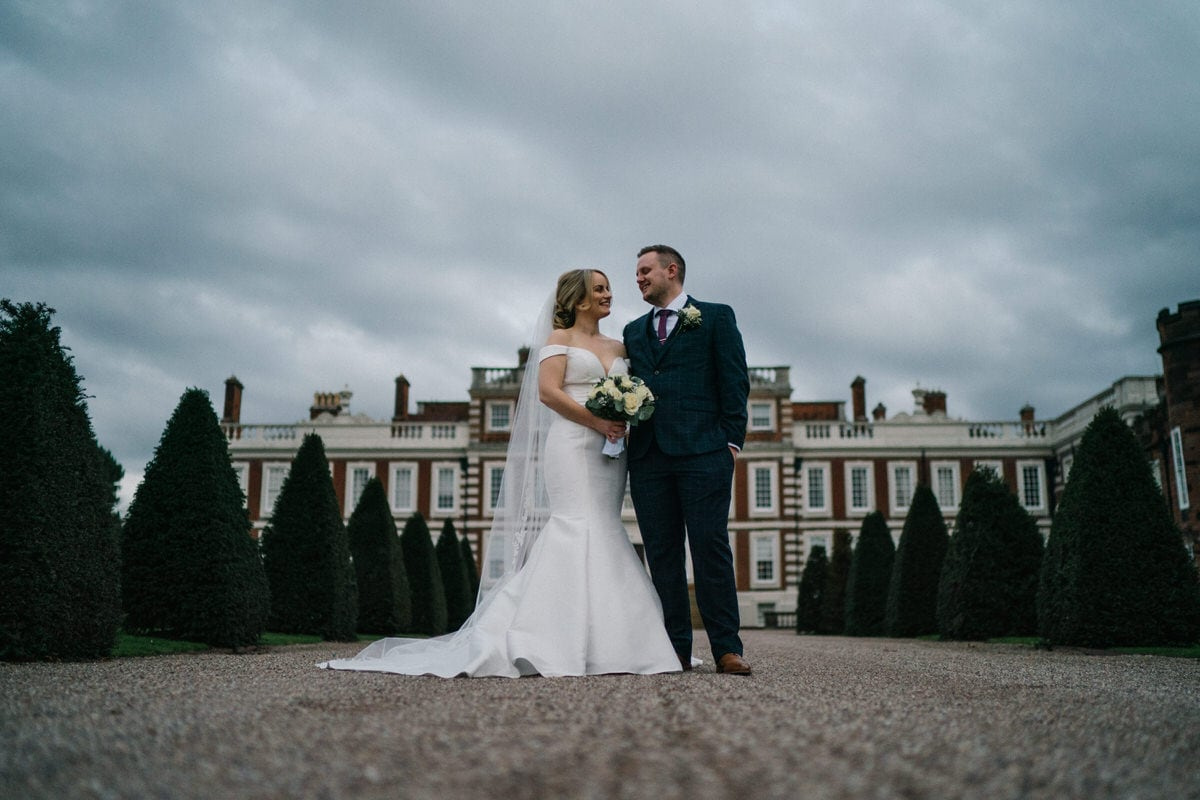 wedding couple in front of knowsley hall