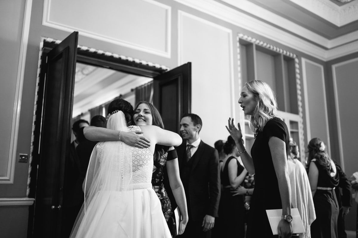 black and white hugs at Manchester hall wedding