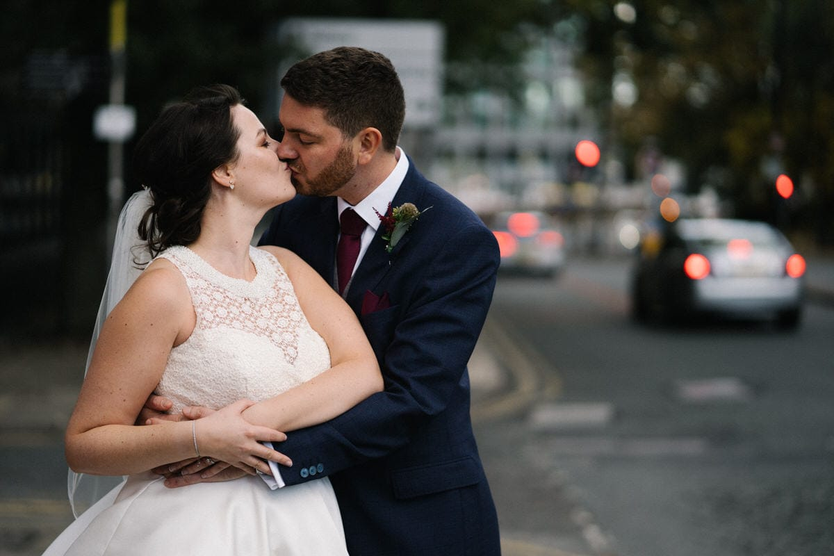 wedding couple kissing in manchester city centre