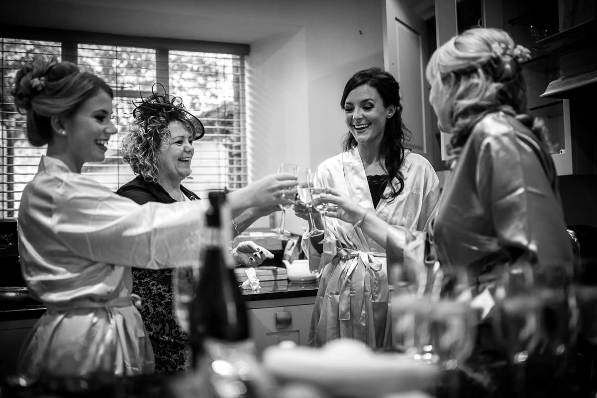 bride toasting her wedding with bridesmaids