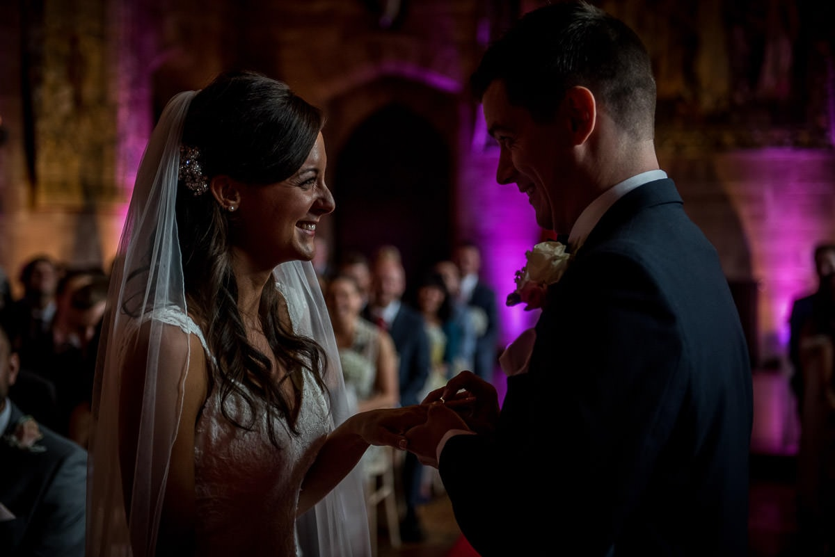 exchange of wedding rings at peckforton castle wedding