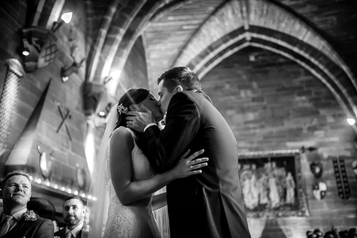 first kiss at peckforton castle wedding