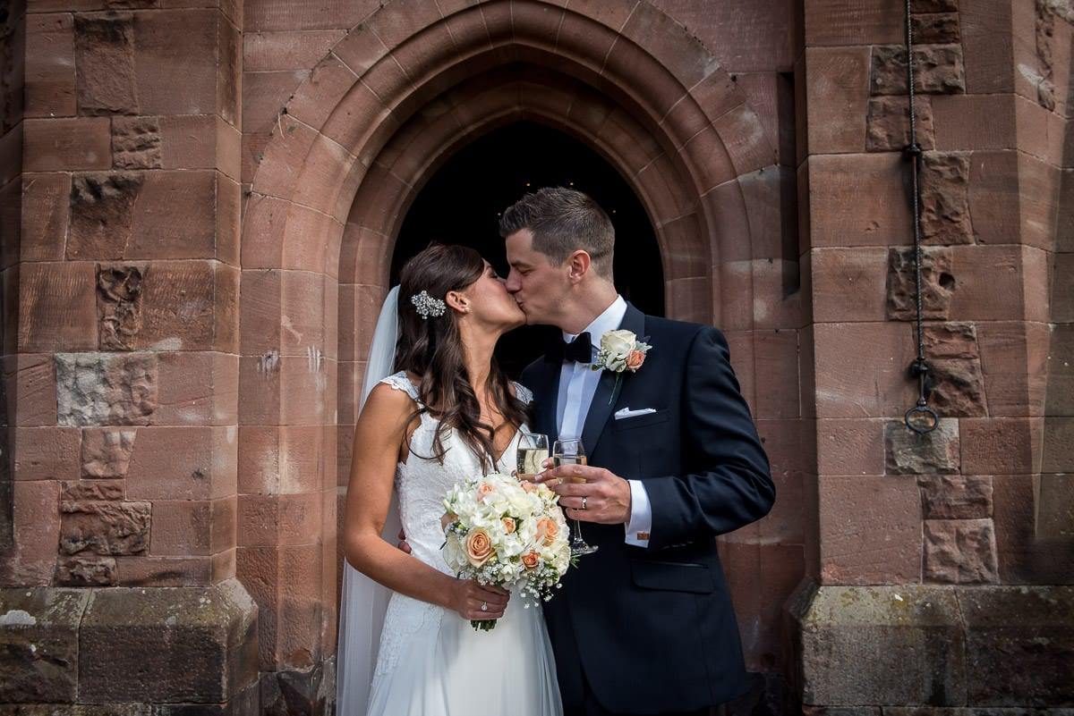 wedding kiss at peckforton castle