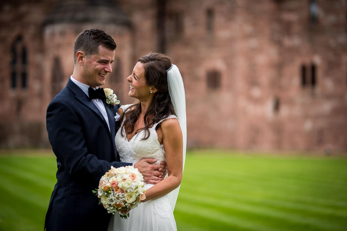 bride and groom at peckforton castle wedding in courtyard