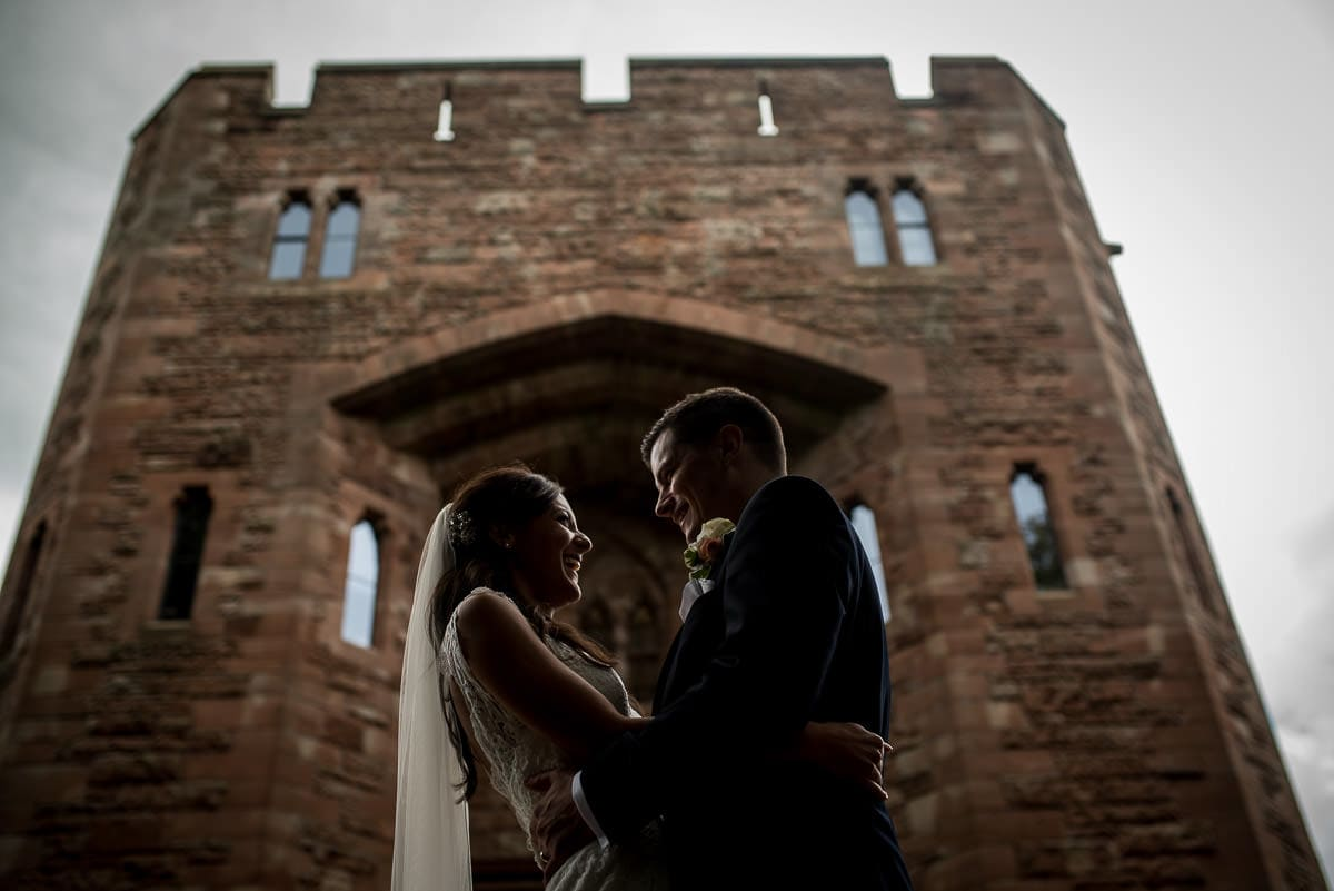 bride and groom outside peckforton castle