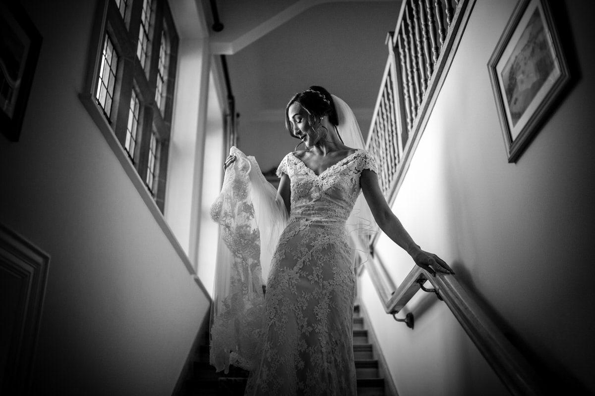 bride walking down the stairs at colshaw hall