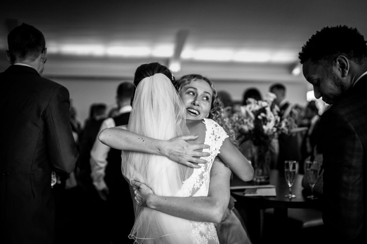 bride being hugged at colshaw hall