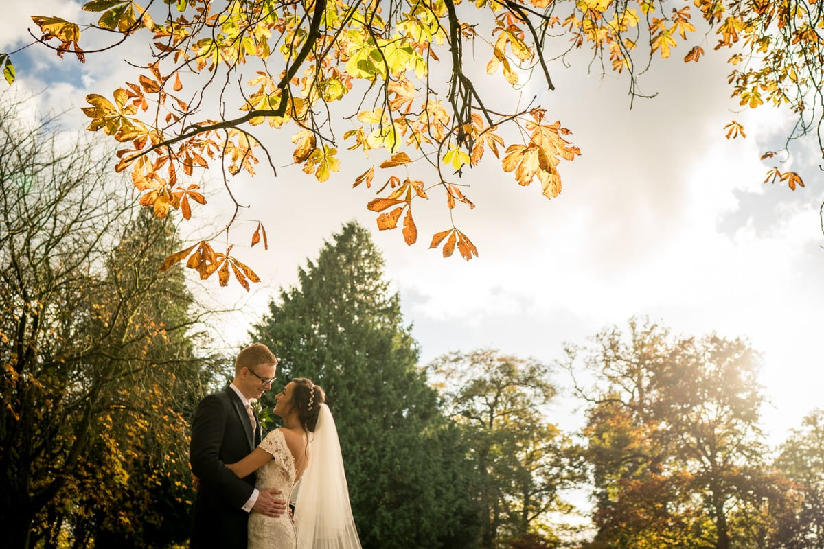 bride and groom in autumnal colours at colshaw hall