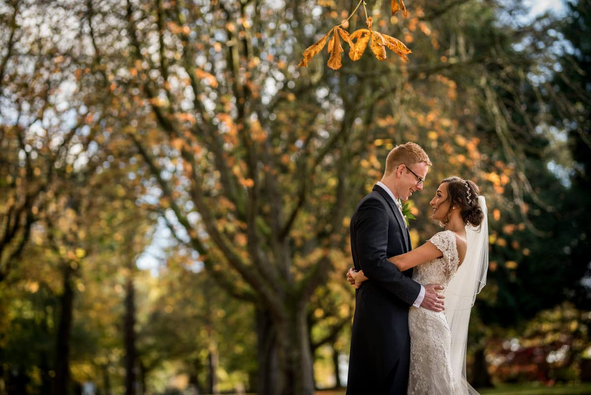 happy couple posing in gardens at colshaw hall