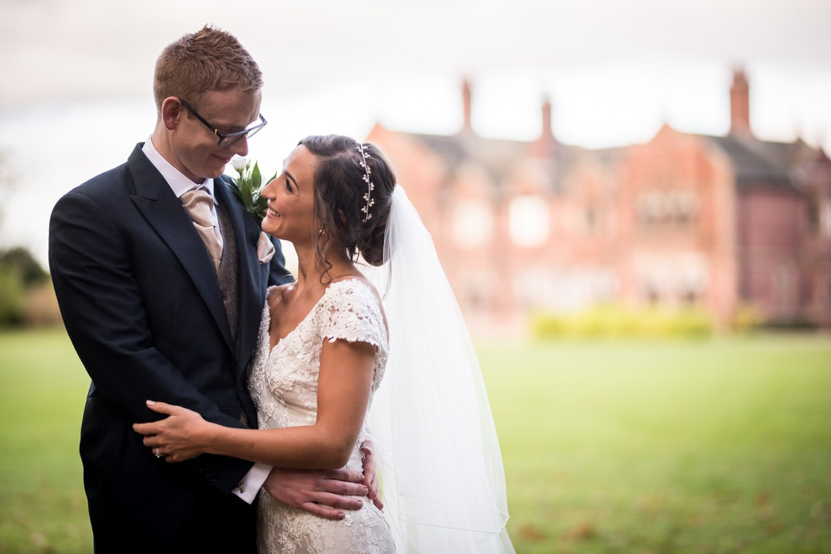bride and groom in front of colshaw hall